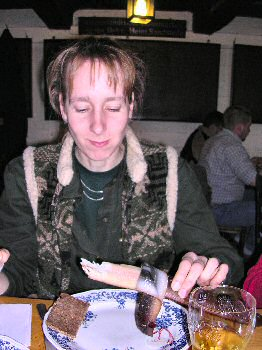 Picture of Imke eating smoked eel