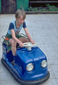 Picture of Armin on a toy car