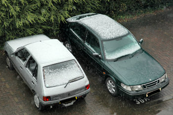 Picture of cars with some snow on them