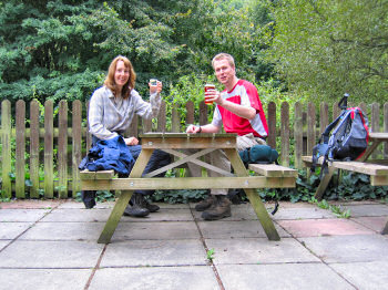 Picture of two people sitting at a beer garden table