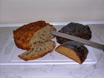 Picture of three breads, some cut open