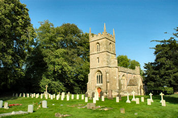 Picture of All Saints Church in Yatesbury, war graves in the foreground