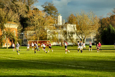 Picture of a football game in the autumn sunshine