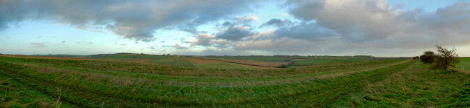 Picture of a panoramic view over fields and hill