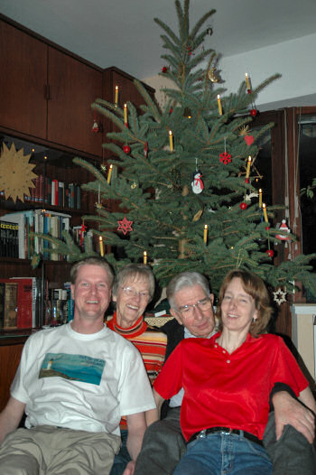 Picture of the Grewe family in front of the Christmas tree