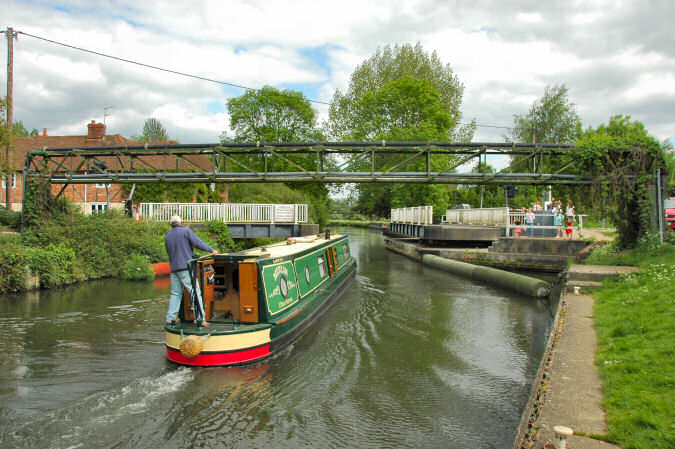 Picture of a canal boat going through a swing bridge