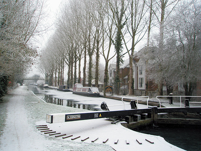 Picture of the end of a canal lock, looking along a wintry canal