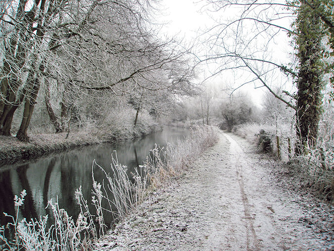 Picture of a canal with a tow path in the winter