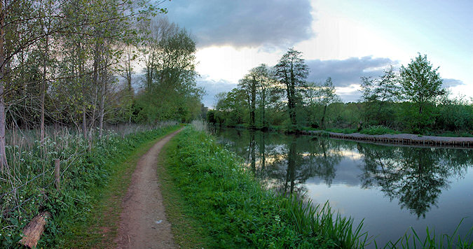 Picture of a panoramic view over a calm canal in the evening light