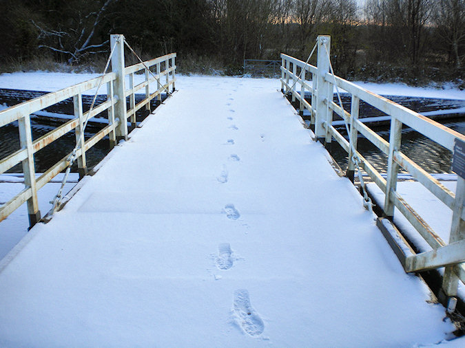 Picture of footsteps in the snow on the bridge
