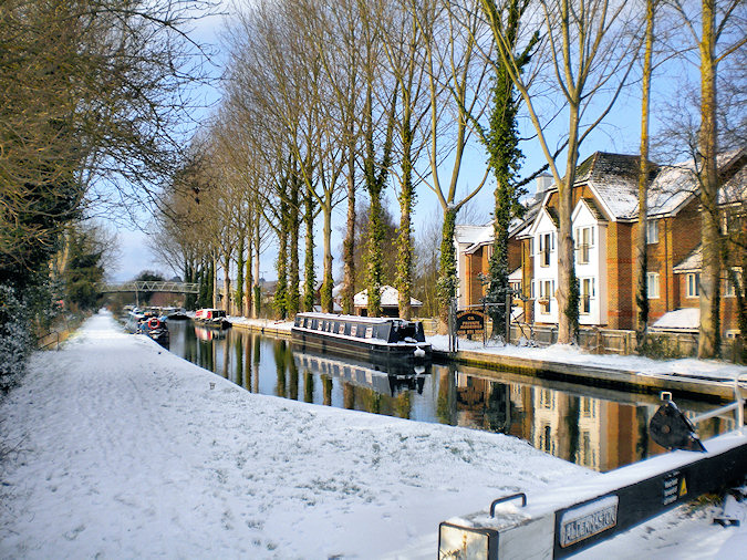Picture of an apartment block next to a canal in the snow