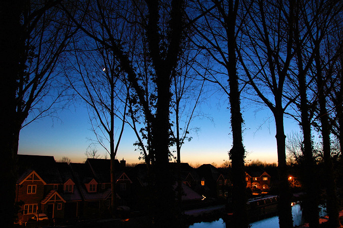 Picture of a view over a canal at last light on a clear cold winter day