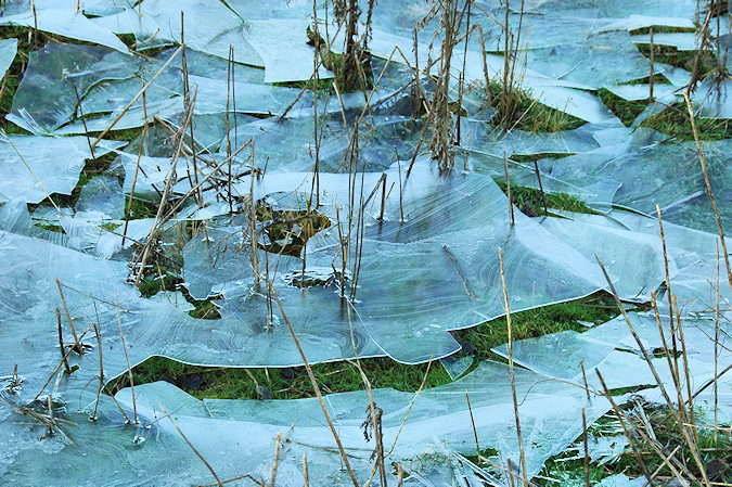 Picture of ice breaking up after the water under it had run off